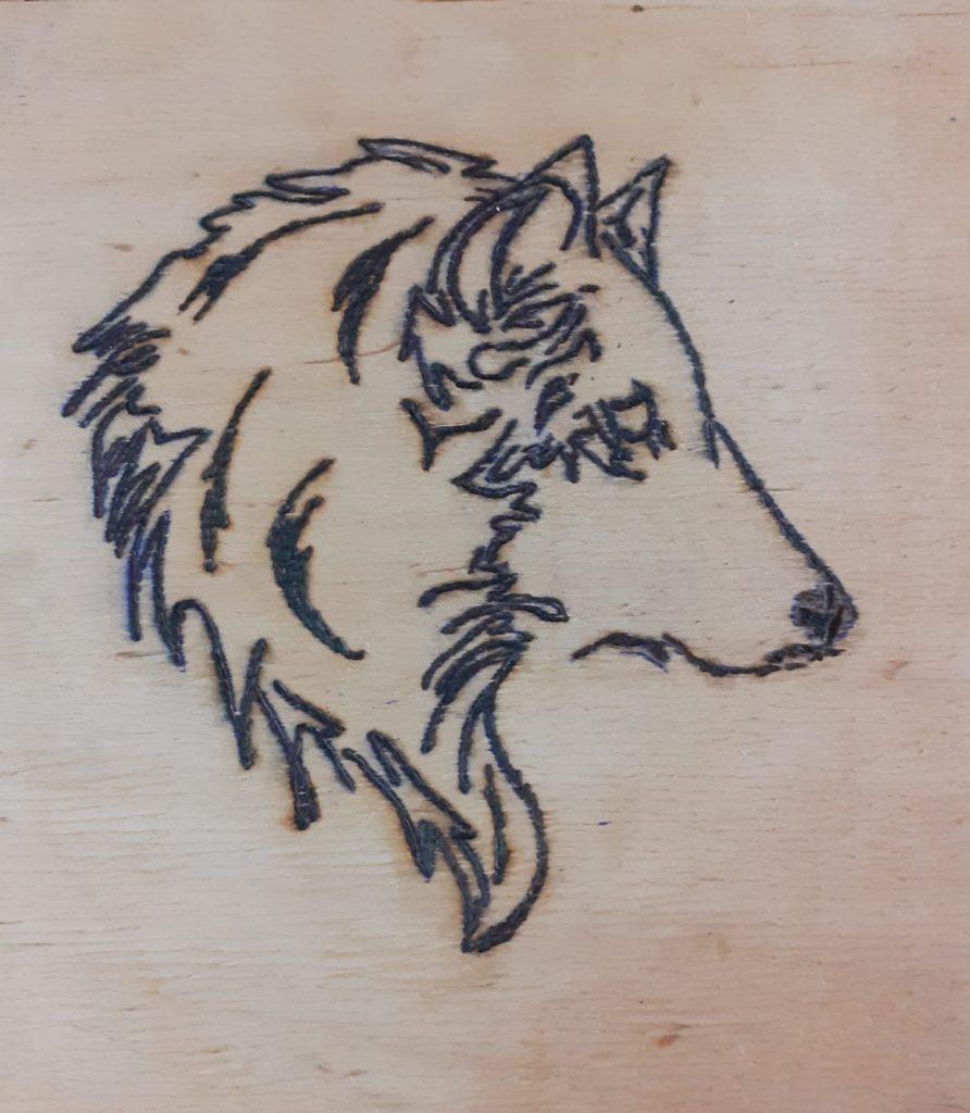 Wypalanka przedstawia profil wilka
